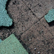 Green torn rubber flooring — Stock Photo