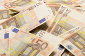Lot of money fifty euros banknotes — Stock Photo
