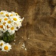 Royalty-Free Stock Photo: Rustic daisy bouquet in vintage style with background for text