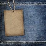 Background denim texture with cardboard label — Stock Photo #11091096