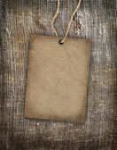 Background texture vintage burlap with label — Stok fotoğraf