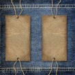 Background denim texture with cardboard label - Zdjęcie stockowe