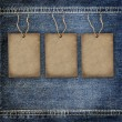 Stock Photo: Background denim texture with cardboard label