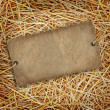 Straw texture background with cardboard label — Stock Photo #11728996