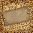 Straw texture background with cardboard label — Stock Photo