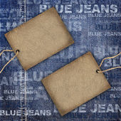 Background denim texture with cardboard label — Stock Photo