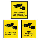 Video surveillance camera sign black and yellow — Stock Vector