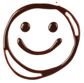Smiley face made of chocolate syrup — Stock Photo