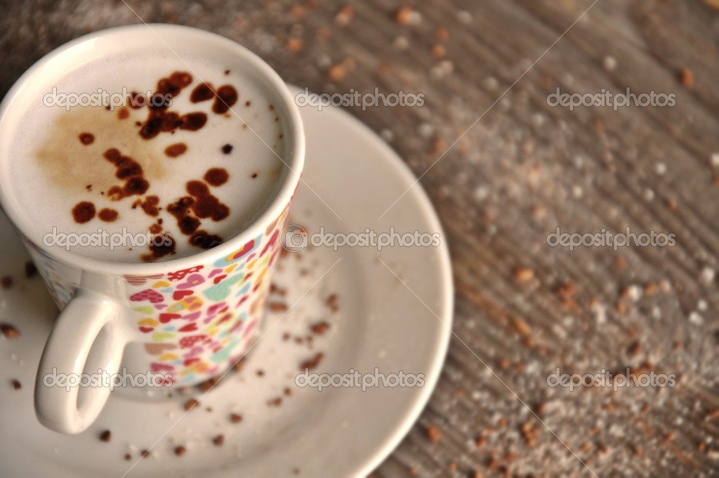 Cup of coffee with hearts on a plate  Stock Photo #10784610
