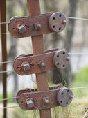 Rusty steel wire fence and tensioner, Scotland. — Stock Photo