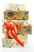 Stack of Gift Boxes and one with Red Bow — Stock Photo
