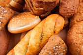Arrangement of baked bread and rolls — Stock Photo