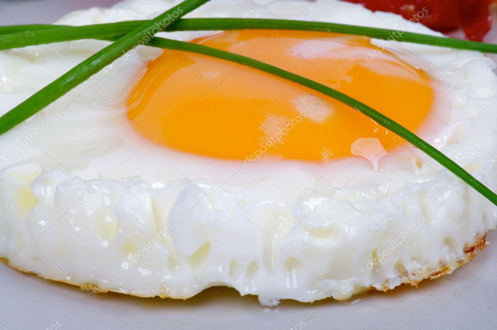 Fried Eggs Sunny Side Up with Onion closeup on gray plate — Stock Photo #11114609