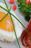 Fried Eggs Sunny Side Up with greens and bacon — Stock Photo