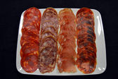 Varied sausage tray — Stock Photo