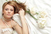Young sexy woman on bed — Stock Photo