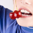 Cherry in mouth — Stock Photo