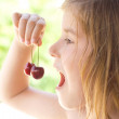 Cherry in the mouth — Stock Photo