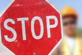 Flag Person Holds Stop Sign — Stock Photo