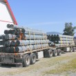 Stock Photo: Semi Trailer Hauls Conduit