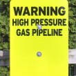 Stock Photo: High Pressure Gas Pipeline Sign