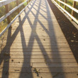 Sunlit Boardwalk — Stock Photo