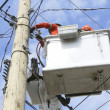 Stock Photo: Two Linemen in Cherry Picker