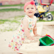 Cute girl playing with the sand — Stock Photo #11391811