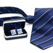 Stock Photo: Man cuff links in box and tie isolated