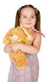 Portrait of cute smiling little girl with toy — Stock Photo