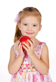 Portrait of cute little girl holding an apple — Stock Photo