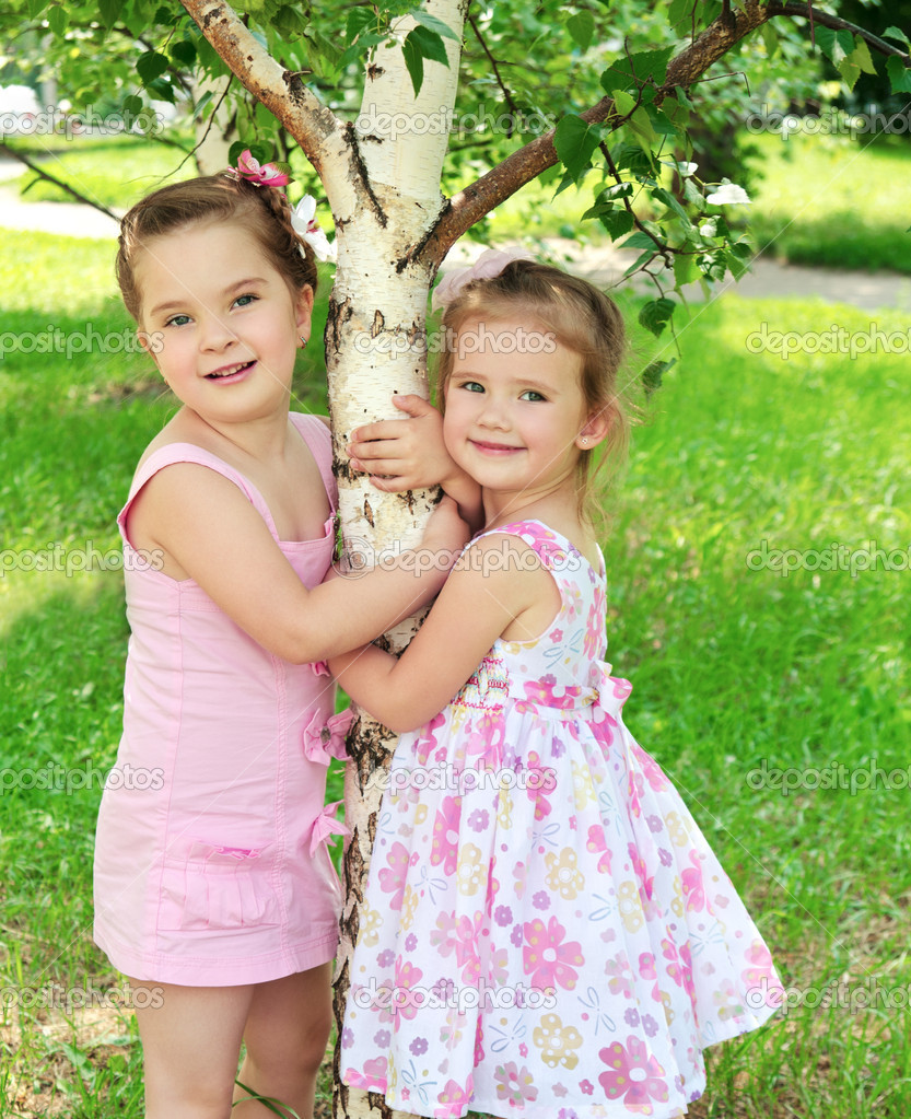 Portrait of two cute little girls outdoor — Stock Photo #11089186