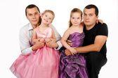 Portrait of two cute little girls with their twins fathers — Stock Photo