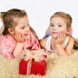 Two little girls talking and gift box — Stock Photo