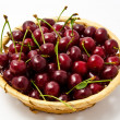 Basket with ripe wet cherry isolated — Stock Photo