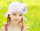 Little girl on the meadow in summer day — Foto Stock