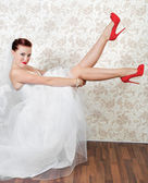 Portrait of beautiful bride in red shoes — Stock Photo