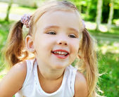 Cute little girl on the meadow — Foto Stock