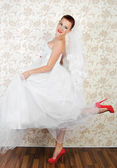 Portrait of young beautiful bride in shoes — Stock Photo