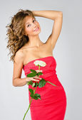 Portrait of beautiful young girl in dress with rose — Stock Photo