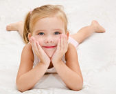 Little girl resting on the bed — Стоковое фото