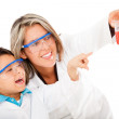 Boy helping mum with an experiment - Stock Photo