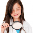 Girl withmagnifying glass — Stock Photo