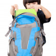 Boy taking notebooks out of backpack — Stock Photo #10734763