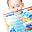 Boy playing with an abacus — Stock Photo