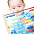 Boy playing with an abacus - Stock Photo