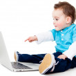 Boy pointing at a laptop — Stock Photo