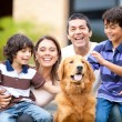Stock Photo: Happy family with dog