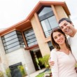 Couple with their house — Stock Photo