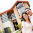Stock Photo: Couple with their house
